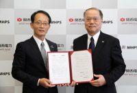 基本合意書を締結した島本・関電取締役(左)と安藤・MHPS社長