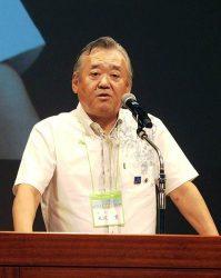信念と情熱、、スピード感を持って事業に取り組むと強調する米沢会長(14日、沖縄県宜野湾市)