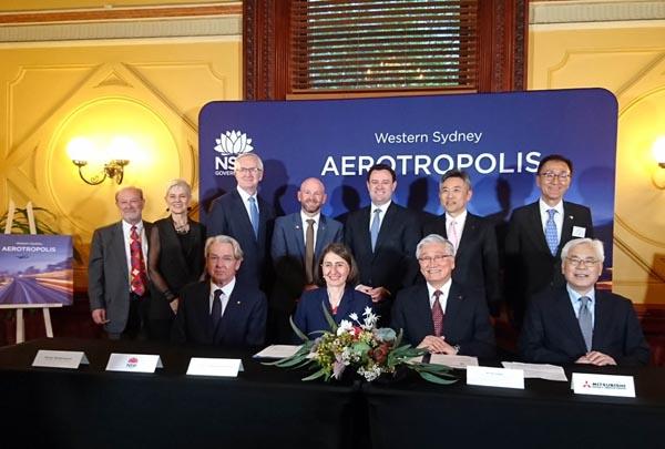 三菱重工業は16日、オーストラリアの西シドニー地域の総合開発に関連し、エネルギー管理などのソリューションを提案することで合意したと発表した。15日に地元のニューサウスウェールズ州政府と了解覚書(MOU)に調印した=写真